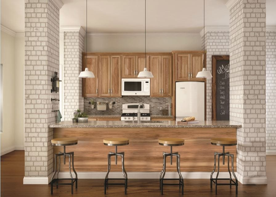 Elements Like Brick Along With Wrought Iron Stools Help Accomplish This  Industrial Look, While The Merillat Cabinetry: Sutton Cliffs In Hickory  Gives This ...